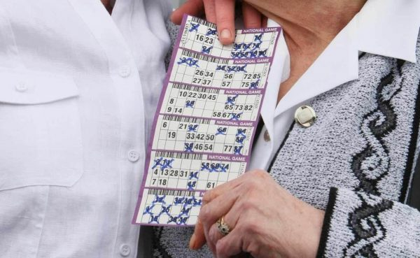 Soraya Lowell and Agnes O'Neill holding the winning National Bingo Game card as they celebrate winning 1.2 million March 2008