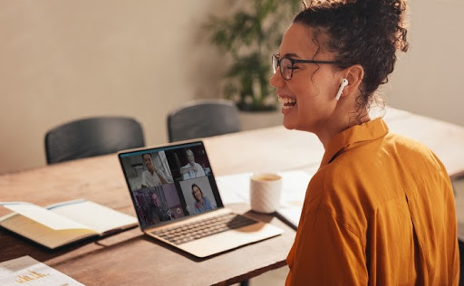 Businesswoman laughing during a video call with coworkers