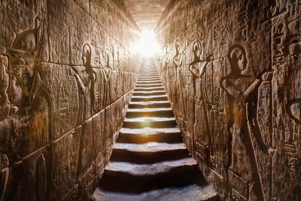 ay of an Egyptian temple with hieroglyphs on the walls and light streaming in