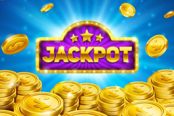 A jackpot sign shines brightly with gold coins stacked up in front of it.