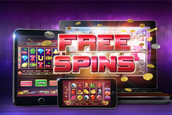 A mobile phone, tablet, and laptop have an online slot game on screen showing that a free-spins bonus round has been triggered.