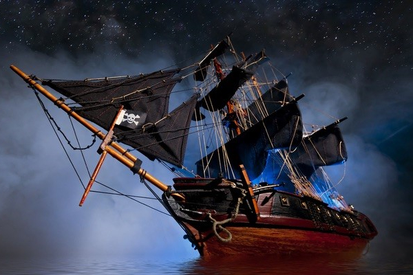 Front view of a pirate ship on misty waters.
